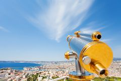 Brass telescope overlooking cityscape of Marseille. At sunny day, France Stock Images
