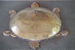 Brass tortoise in a temple Stock Photo