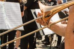 Brass Trombone, Golden Saxophone in Background Stock Image