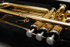 Brass trumpet. A close up of the brass trumpet valves royalty free stock photo