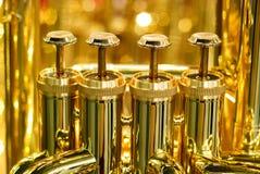 Brass tuba detail. Golden tuba brass valve detail Stock Photos