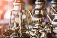 Brass utensils shop, Kathmandu market, Nepal. Brass utensils shop with handicrafts and souvenirs in Kathmandu market, Nepal Stock Photo
