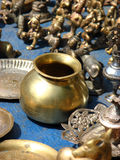 Brass Vessel. An antique traditional brass vessel used for hindu religious purposes shot in a shop of antique items in India Royalty Free Stock Photo