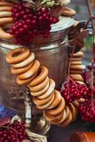 Brass vintage samovar, a bundle of bagels, red berries as a symbol of Russian hospitality.  Royalty Free Stock Photo