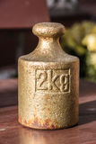Brass weight. (2kg) in a sunny day royalty free stock photos