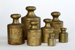 Brass weights (2kg, 1kg, 500g, 200g, 100g) stock photos