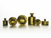 Brass weights of an old weighing scale. Weights measured in kilograms Royalty Free Stock Photo