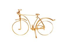 Brass wire bicycle. Toy bicycle made of brass wire Stock Image
