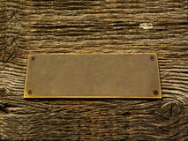 Brass on wood sign. In Romania Stock Images