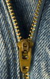 Brass Zipper. Closeup image of a zipper on a pair of jeans stock photos