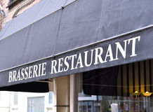 Brasserie restaurant. Close-up of the building exterior of an old restaurant awning with white letters Stock Image