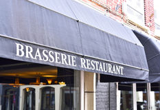 Brasserie restaurant. Close-up of the building exterior of an old restaurant awning with white letters Royalty Free Stock Photo