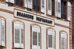 Brasserie restaurant. Brasserie and Restaurant, written on a facade in france Stock Photos