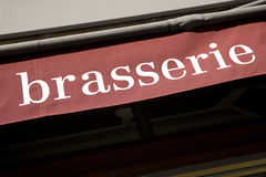 Brasserie Sign. On red background, Paris, France, Europe Royalty Free Stock Image