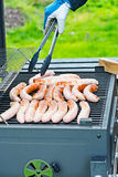 Brat sausage are on the charcoal grill Stock Photography