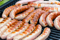 Brat sausage are on the charcoal grill Royalty Free Stock Photo