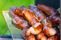 Brat sausages are grilled on the charcoal grill Stock Photo