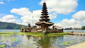 Bratan Lake, Bali Indonesia. Pura Ulun Danu Bratan, or Pura Bratan, is a major Shivaite and water temple on Bali, Indonesia. The temple complex is located on the Royalty Free Stock Photo