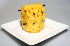 Braten-Ananas-und Vanille-Hülsen stockbild