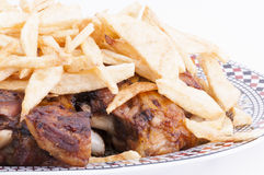 Bratenlamm mit Chips Stockbilder