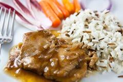 Bratenschweinefleisch mit Reis stockbild