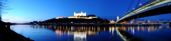 Bratislava. Castle above the Danube at night panorama Stock Images