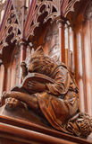 Bratislava - Bear at reading symbolic carved sculpture from bench in st. Matins cathedral Stock Images
