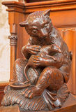Bratislava - Bear and rodent carved symbolic  sculpture from bench in st. Matins cathedral. BRATISLAVA, SLOVAKIA - FEBRUARY 11, 2014: Bear and rodent carved Royalty Free Stock Photos