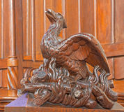 Bratislava - Bird on the fire symbolic carved sculpture from bench in st. Matins cathedral. BRATISLAVA, SLOVAKIA - FEBRUARY 11, 2014: Bird on the fire symbolic Royalty Free Stock Photography