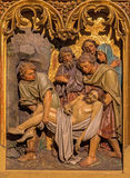 Bratislava - Burial of Jesus scene. Carved relief from 19. cent. in st. Martin cathedral. Royalty Free Stock Photography