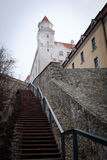Bratislava Castle. One entrance of the Bratislava Castle or Bratislava Hrad, showing one tower of the Baroque building, a stone wall and the stairs leading to royalty free stock photography