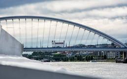Bratislava castle behind modern Apollo bridge, cruise on the Dan Stock Images