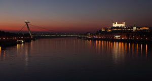 Bratislava castle and bridge at twilght Royalty Free Stock Photography