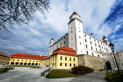 Bratislava castle courtyard and palace at sunny cloudy spring da. Y in capital city of Slovak republic. Beautiful famous medieval fortress, cultural heritage Royalty Free Stock Image
