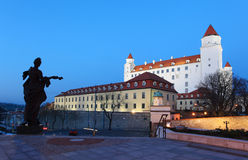 Bratislava castle from parliament at twilight Royalty Free Stock Images