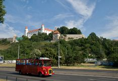 Bratislava castle and red sightseeing bus Royalty Free Stock Photos