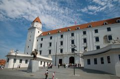 Bratislava Castle and the statue of King Svatopluck in front Royalty Free Stock Image