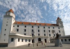 Bratislava Castle and the statue of King Svatopluck in front Royalty Free Stock Images