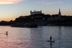 Bratislava city skyline and Danube river with paddle boarding people at the sunset, Bra stock photos
