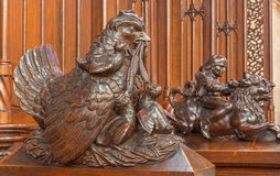 Bratislava - Clocking hens symbolic sculpture from bench in presbytery in st. Matins cathedral. BRATISLAVA, SLOVAKIA - FEBRUARY 11, 2014: Clocking hens symbolic Stock Image