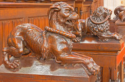 Bratislava - Dog symbolic carved sculpture from bench in presbytery in st. Matins cathedral. BRATISLAVA, SLOVAKIA - FEBRUARY 11, 2014: Dog symbolic carved Royalty Free Stock Photos