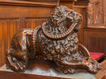 Bratislava - Dog symbolic carved sculpture from bench in presbytery in st. Matins cathedral. BRATISLAVA, SLOVAKIA - FEBRUARY 11, 2014: Dog symbolic carved Royalty Free Stock Image