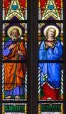 Bratislava - jungfruliga Mary och St Joseph på fönsterruta från 19. från den St Martin domkyrkan. Arkivfoto