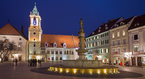 Bratislava - Main square in evening dusk with the town hall and Jesuits church. Stock Image