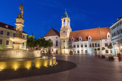 Bratislava - Main square in evening dusk with the town hall and Jesuits church. Royalty Free Stock Photography