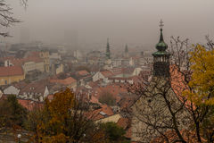 Bratislava misty towers. Bratislava view from the castle.  Misty atmosphere hides the more modern buildings Royalty Free Stock Photo