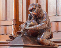 Bratislava - The monkey with the pipe sculpture from bench in presbytery in st. Matins cathedral Royalty Free Stock Image