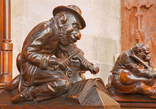 Bratislava - Monkey with the violin sculpture from bench in presbytery in st. Matins cathedral Stock Photos