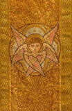 Bratislava - The Needelwork of cherub with the the catholic vestment from 19. cent. in st. Martins cathedral. Stock Photography