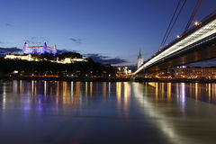 Bratislava at night. The night panorama of Bratislava represented by the Bratislava Castle and so-called New bridge over the river Danube royalty free stock image